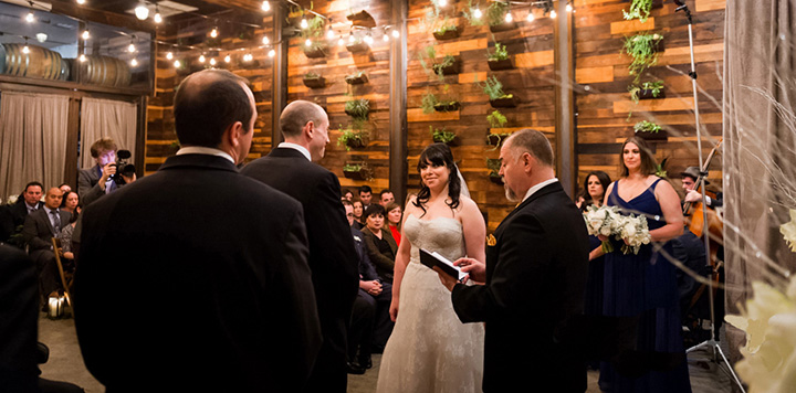 NYC Wedding Officiant Peter Boruchowitz pronounces the Bride and Groom married in front of guests at the Brooklyn Winery