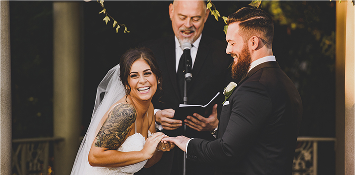 Happy bride makes groom and NYC Wedding Officiant laugh