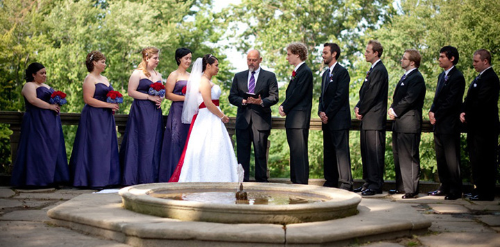 Bridesmaids and Groomsmen watch NYC Wedding Officiant Peter Boruchowitz perform wedding ceremony