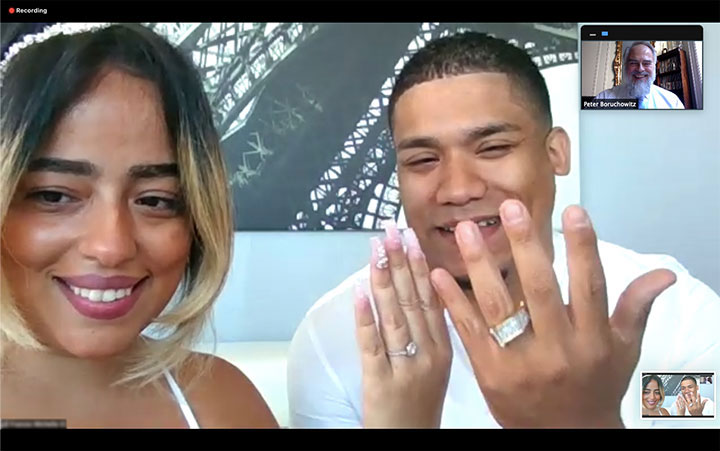 Newlyweds show off their rings after virtual wedding in New York